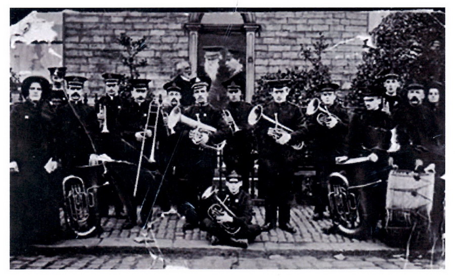 General Booth (in doorway)and the New Mills Salvation Army Band at a house on High Street, opposite the Masons Arms!