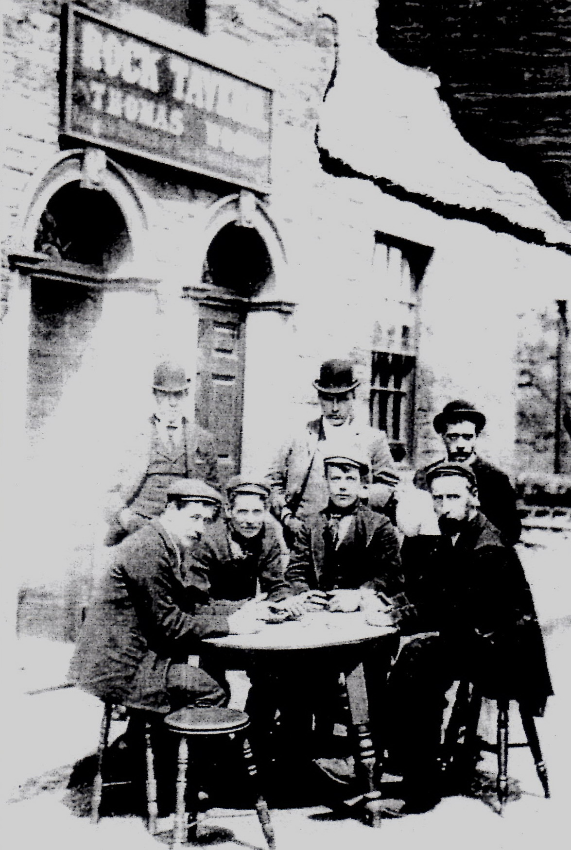 Thomas Wood (standing centre) with his sons either side and seated customers.