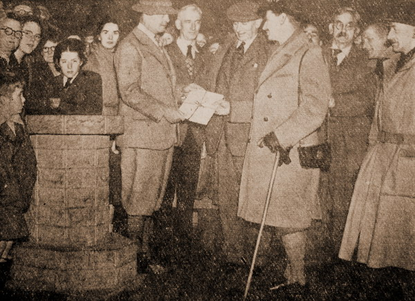 Mr Molson hands the deeds to to Major G.G. Havthornthwaite