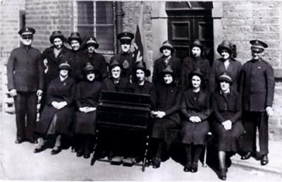 Salvation Army Songsters in High Street. Jane Wigley far left front row, Irene Pyatt behind her.